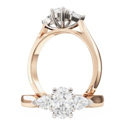 A stylish Oval Cut diamond ring with Pear shoulder stones in 18ct rose & white gold
