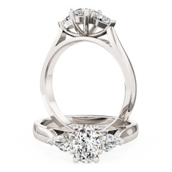 A stylish oval cut and pear shape diamond three stone in 18ct white gold