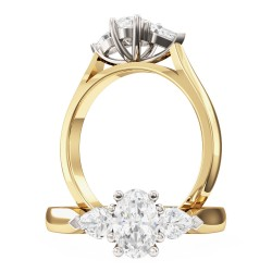 A stylish Oval Cut diamond ring with Pear shoulder stones in 18ct yellow & white gold