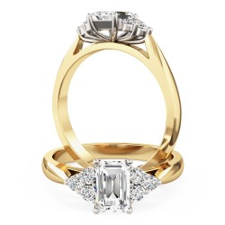 A classic Emerald Cut diamond ring with small Round shoulder stones in 18ct yellow & white gold