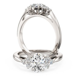 A classic Oval Cut diamond ring with shoulder stones in platinum