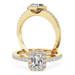 A stunning emerald cut diamond ring with shoulder stones in 18ct yellow gold