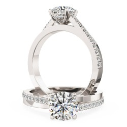 A delightful round brilliant cut diamond ring with shoulder stones in platinum