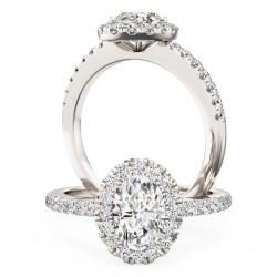 A stunning oval cut diamond halo with shoulder stones in platinum