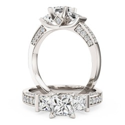 A breathtaking three stone diamond ring with shoulder stones in 18ct white gold