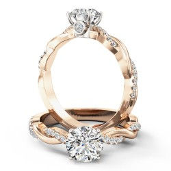 A stunning Round Brilliant Cut diamond ring with shoulder stones in 18ct rose & white gold