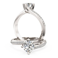 An exquisite solitaire diamond ring with shoulder stones in platinum