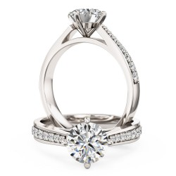An exquisite solitaire diamond ring with shoulder stones in 18ct white gold