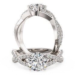 A beautiful Round Brilliant Cut diamond ring with shoulder stones in platinum