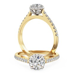 A round brilliant cut halo diamond ring with shoulder stones in 18ct yellow & white gold