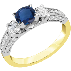 A luxurious sapphire & diamond ring with shoulder stones in 18ct yellow & white gold