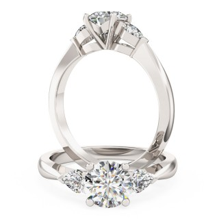 A beautiful Round Brilliant Cut diamond ring with Pear shoulder stones in 18ct white gold