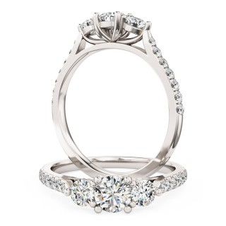 A classic Round Brilliant Cut three stone diamond ring with shoulder stones in 18ct white gold