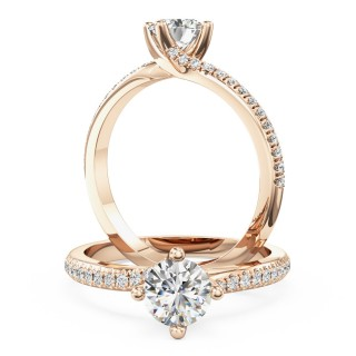 An exquisite solitaire diamond ring with shoulder stones in 18ct rose gold