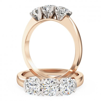 An eye catching round brilliant cut three stone diamond ring in 18ct rose & white gold