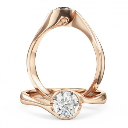 A unique round brilliant cut solitaire diamond ring in 18ct rose gold