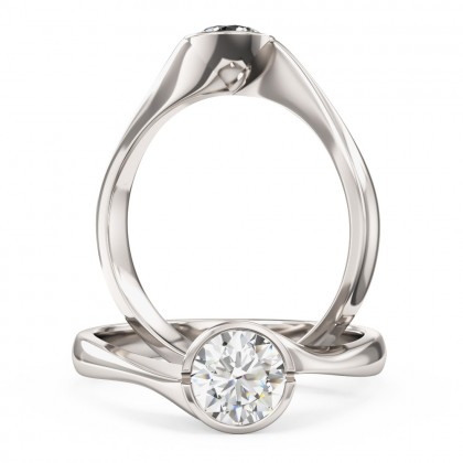 A unique Round Brilliant Cut solitaire diamond ring in platinum