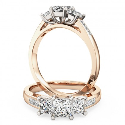 A stunning three stone princess cut diamond ring with shoulders stone in 18ct rose & white gold