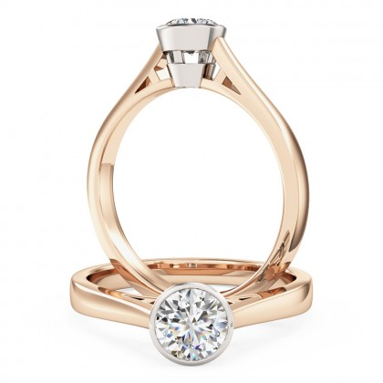 A modern round brilliant cut solitaire diamond ring in 18ct rose & white gold
