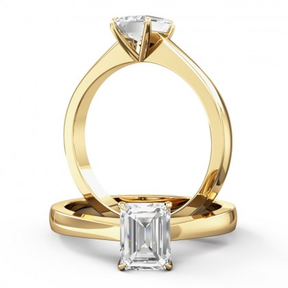 An elegant emerald cut solitaire diamond ring in 18ct yellow gold