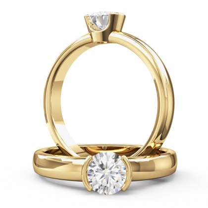 A beautiful round brilliant cut solitaire diamond ring in 18ct yellow gold