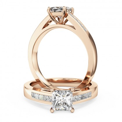 A striking princess cut diamond ring with shoulder stones in 18ct rose gold