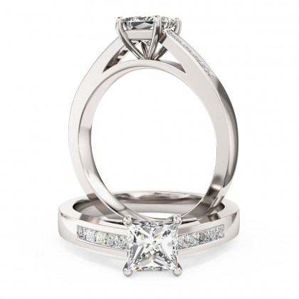 A striking Princess Cut diamond ring with shoulder stones in platinum (In stock)