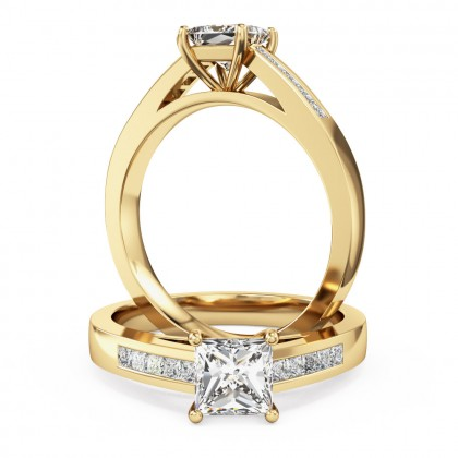 A striking princess cut diamond ring with shoulder stones in 18ct yellow gold