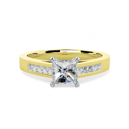 A striking Princess Cut diamond ring with shoulder stones in 18ct yellow & white gold