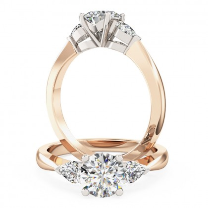 A beautiful round brilliant cut diamond ring with pear shoulder stones in 18ct rose & white gold