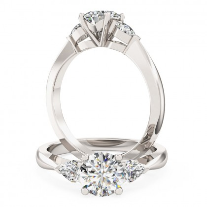 A beautiful Round Brilliant Cut diamond ring with Pear shoulder stones in 18ct white gold (In stock)