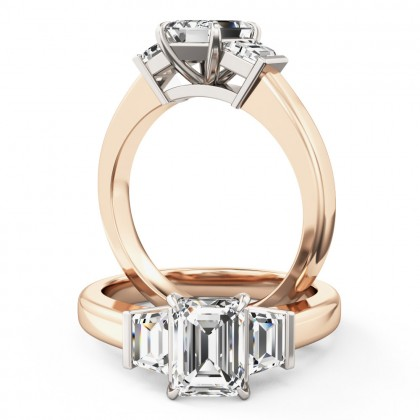 A wonderful emerald cut diamond ring with shoulder stones in 18ct rose & white gold