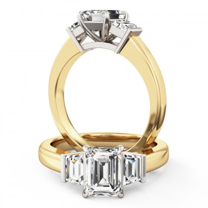 A wonderful emerald cut diamond ring with shoulder stones in 18ct yellow & white gold