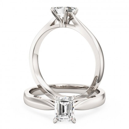 A classic emerald cut solitaire diamond ring in platinum