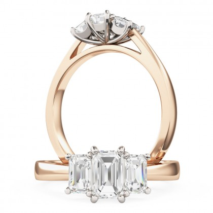 A beautiful Emerald Cut three stone diamond ring in 18ct rose & white gold