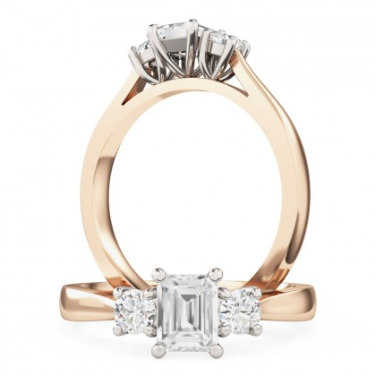 An emerald cut and round brilliant cut three stone diamond ring in 18ct rose & white gold