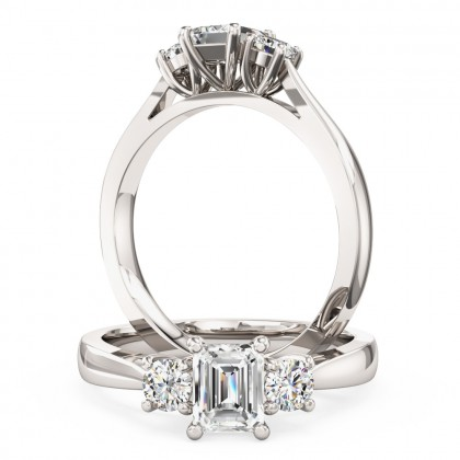 An emerald cut and round brilliant cut three stone diamond ring in platinum