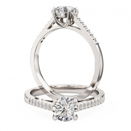 A dazzling Round Brilliant Cut diamond ring with shoulder stones in 18ct white gold