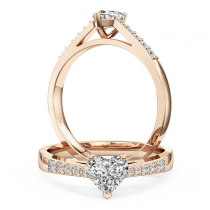 A charming heart shaped diamond ring with shoulder stones in 18ct rose gold