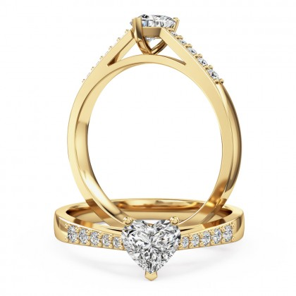 A charming heart shaped diamond ring with shoulder stones in 18ct yellow gold