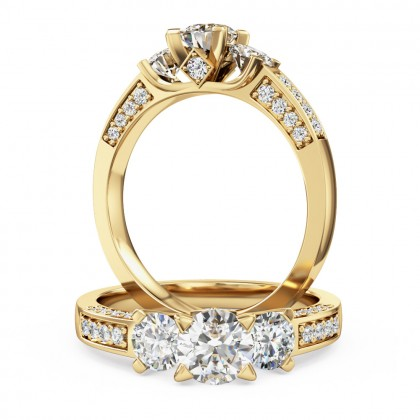A breathtaking diamond three stone ring with shoulder stones in 18ct yellow gold