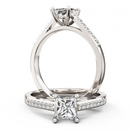 An elegant Princess Cut diamond ring with shoulder stones in platinum