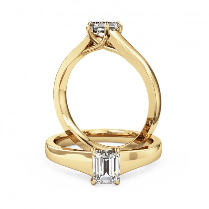 A stunning emerald cut solitaire diamond ring in 18ct yellow gold