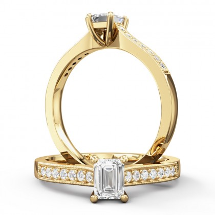 A beautiful emerald cut diamond ring with shoulder stones in 18ct yellow gold