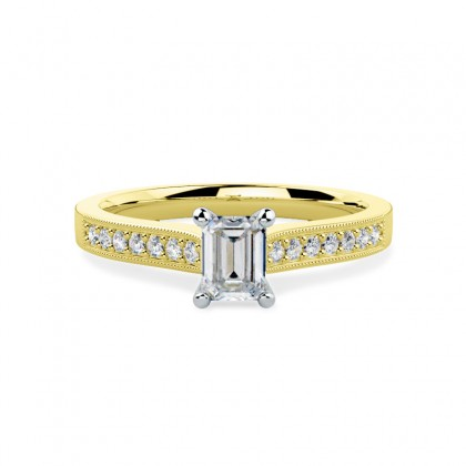 A beautiful Emerald Cut diamond ring with shoulder stones in 18ct yellow & white gold