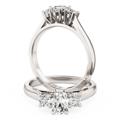 A stunning oval and round brilliant c three stone diamond ring in 18ct white gold