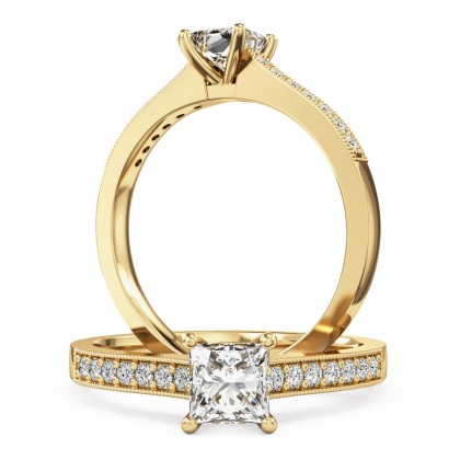 A beautiful princess cut diamond ring with shoulder stones in 18ct yellow gold