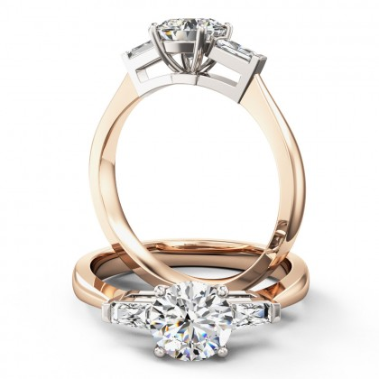 A stylish round brilliant cut diamond ring with shoulder stones in 18ct rose & white gold