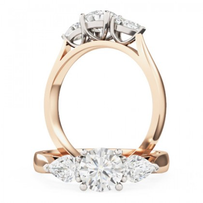 An elegant Round Brilliant Cut diamond ring with Pear shoulder stones in 18ct rose & white gold