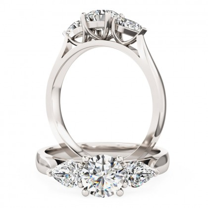 An elegant Round Brilliant Cut diamond ring with Pear shoulder stones in platinum
